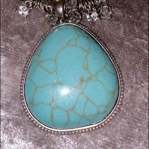 A turquoise pendent necklace